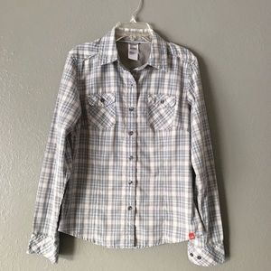 The North face button up top.